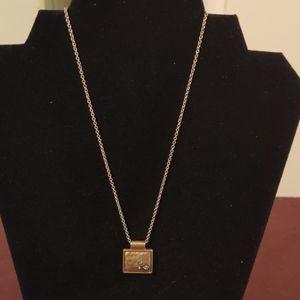 Matte gold Lia Sophia necklace with pendant